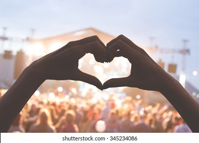 She loves this band! Heart shape for the music. - Shutterstock ID 345234086