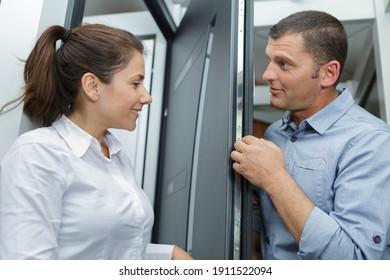 she is opening a door