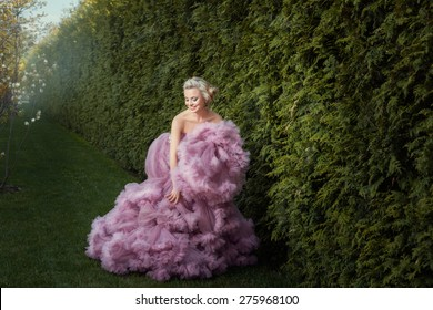 She pats his hand magnificent pink ball gown. She's in the garden.