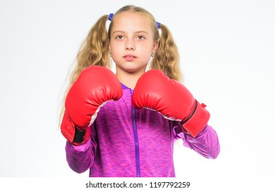 She ready to defend herself. Sport upbringing for girls. Feminist movement. Self defence concept. Girl boxer knows how defend herself. Girl child strong with boxing gloves posing on white background.