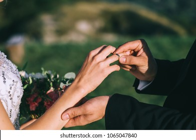 She said yes concept suited up man fiance groom hands stylish platinum w