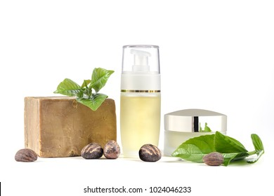 Shea Butter nuts on white with cosmetic products, soap, cream and oil or gel.