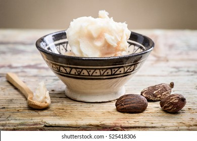 shea butter and nuts on a wooden table