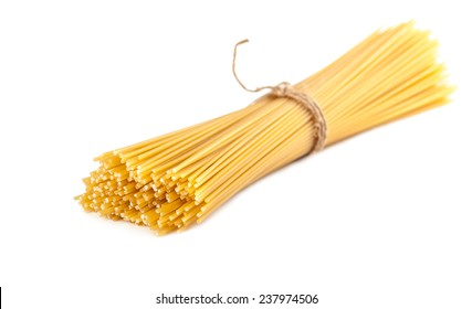 sheaf raw spaghetti on a white background isolated