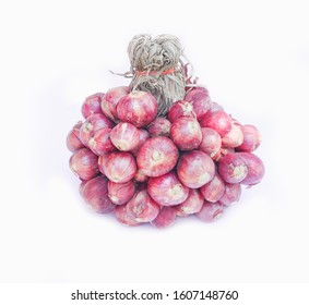 Sheaf of red onions on white background