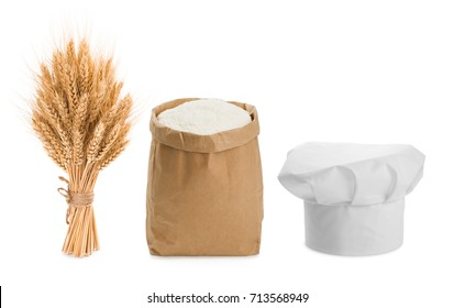 Sheaf of wheat, chefs hat and flour isolated on white