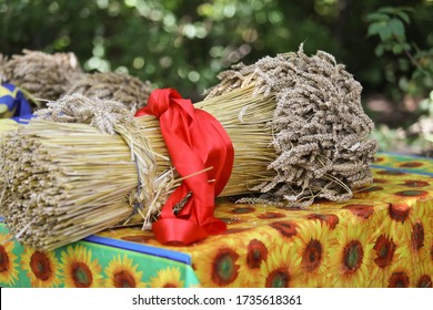 A sheaf of wheat lies on the table. Harvest Festival