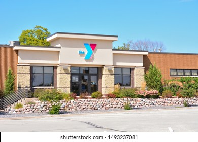 Sheboygan Falls, Wisconsin / USA - August 30, 2019:  The YMCA building in the downtown area on a clear late summer day with an empty parking lot.