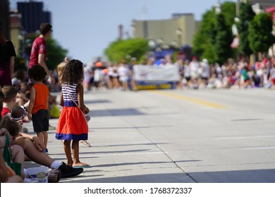Sheboygan, Wisconsin / USA - July 4th, 2020: Many community members came out to be a spectator to watch  freedom pride festival parade marching downtown in the city.