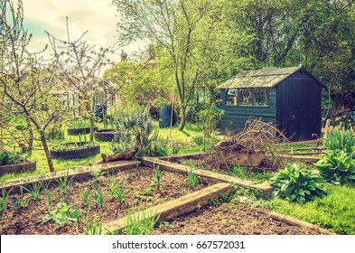 Shed in an allotment with soil ready to plant. Horizontal view.