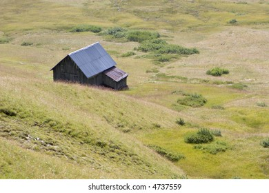 shed in dolomites meadow