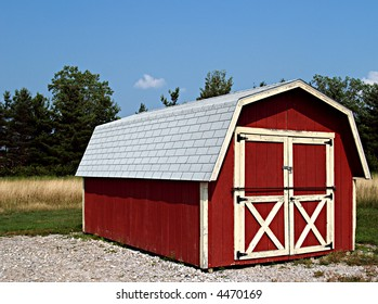 Shed made to look like a small red barn on a farm