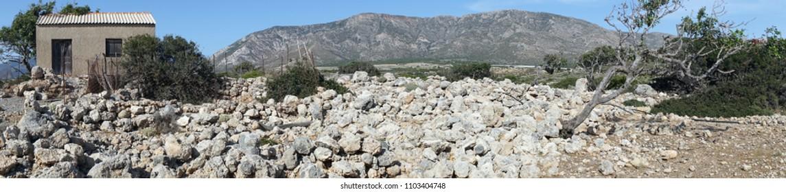 Shed and rocks in coastal area of Krete island, Greece