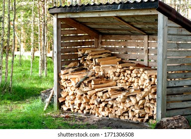 shed for storing firewood with dry firewood.