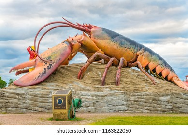 """SHEDIAC, CANADA - JUNE 19,2018 - Lobster sculpture near entrance to the town Shediac. The town is known as the """"Lobster Capital of the World""""."""