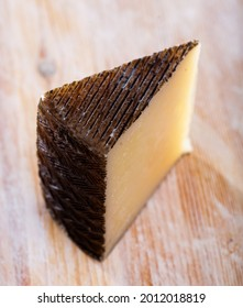 Sheep cheese with intense flavor, distinct sheep aroma, dense texture, ivory color and small irregular holes