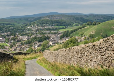 Sheep grazing above the Yorkshire Dales village of Settle in Stockdale