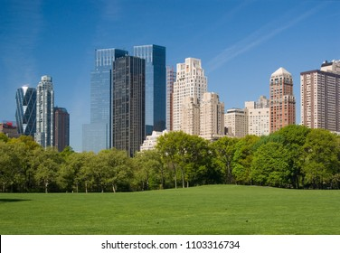 Sheep Meadow in Central Park with the skyline of Central Park West in the background