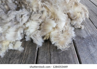 Sheep wool on a wooden table.