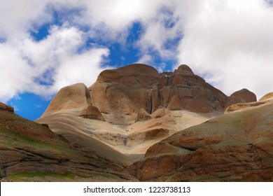 sheer forbidding rock, smoothed stone, one of four faces of Mount Kailash, Tibet, a bottom view