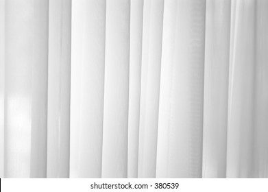 Sheer white voile curtain background