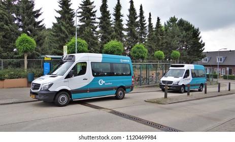 's-Heerenberg / Netherlands - June 6 2018: Two neighborhood buses (Mercedes Benz Sprinter) of Arriva at the busstation of 's-Heerenberg in the Achterhoek.