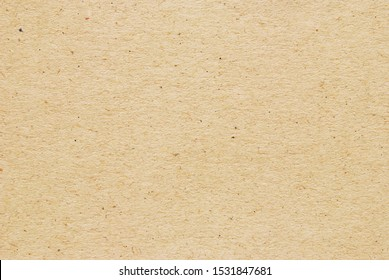 A sheet of brown recycled craft paper texture as background