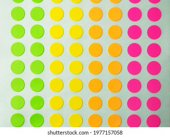 Sheet of circle labels or dot sticker in various neon colors.  also called coding Dot Labels. Close-up macro from above.