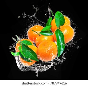 Sheet clementines fall into Bowl in water, water splashes