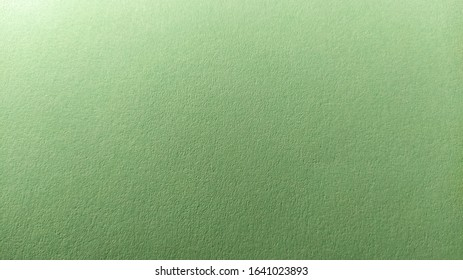 A sheet of light green paper with vignetting at the bottom. Calm green with fine paper texture. Soothing interior color