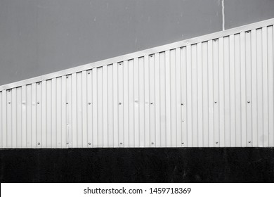sheet metal fixed to the building wall diagonally