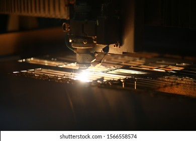 Sheet metal plate with sparking light. Modern industrial technology concept. Manufacturing finished parts for automotive production. Blurred dark background