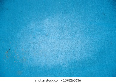 Sheet metal profile painted in blue with rust