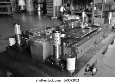 Sheet Metal Stamping Tool Die for Automotive Precision Parts. Tandem Stamping System. At a High Quality Technology Factory.  Black and White Photography.