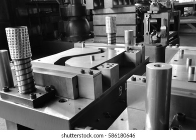 Sheet Metal Stamping Tool Die for Automotive Precision Parts on The Numerical Control Milling Machine Table. Tandem Stamping System. At a High Quality Technology Factory. Black and White Photography.