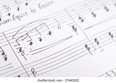 sheet music with pen and without