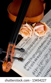Sheet music of the Wedding March; with roses and violin