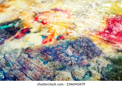 Sheet on paper sozzled by colorful inks. Abstract colorful background with textured effect.