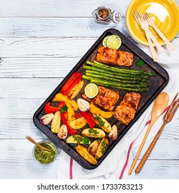 Sheet Pan Baked Salmon Fish with Roasted Asparagus, Potatoes and Bell Pepper Dinner. Selective focus.