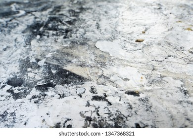 Sheet of paper damaged by chemical reaction. Corrosive acid-alkaline corrosive contamination conceptual background.