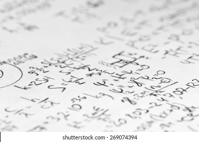 sheet of paper filled with calculations of nuclear and quantum physics as a background