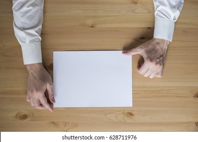 a sheet of paper on the desk and hands, the handle, top view,