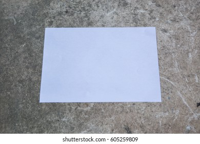 Sheet of paper on the floor