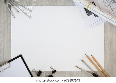 The sheet of paper on a table with office supplies. Idea business. Sketch. Workers place. Place for the text