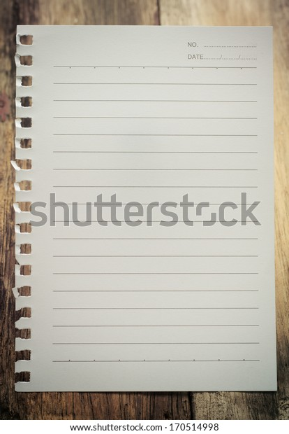 sheet of paper on wood background