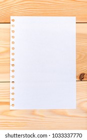 a sheet of paper on wooden boards - blank for writing