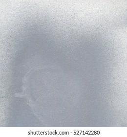 A sheet of paper painted in silver gray color.Useful as textured background