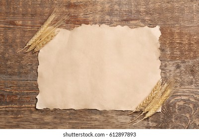Sheet of paper with space for text on wooden background