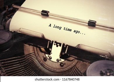 "Sheet of paper with text ""A long time ago"" in old typewrite, closeup"