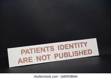sheet of paper with text Patients identity are not published with a black background.